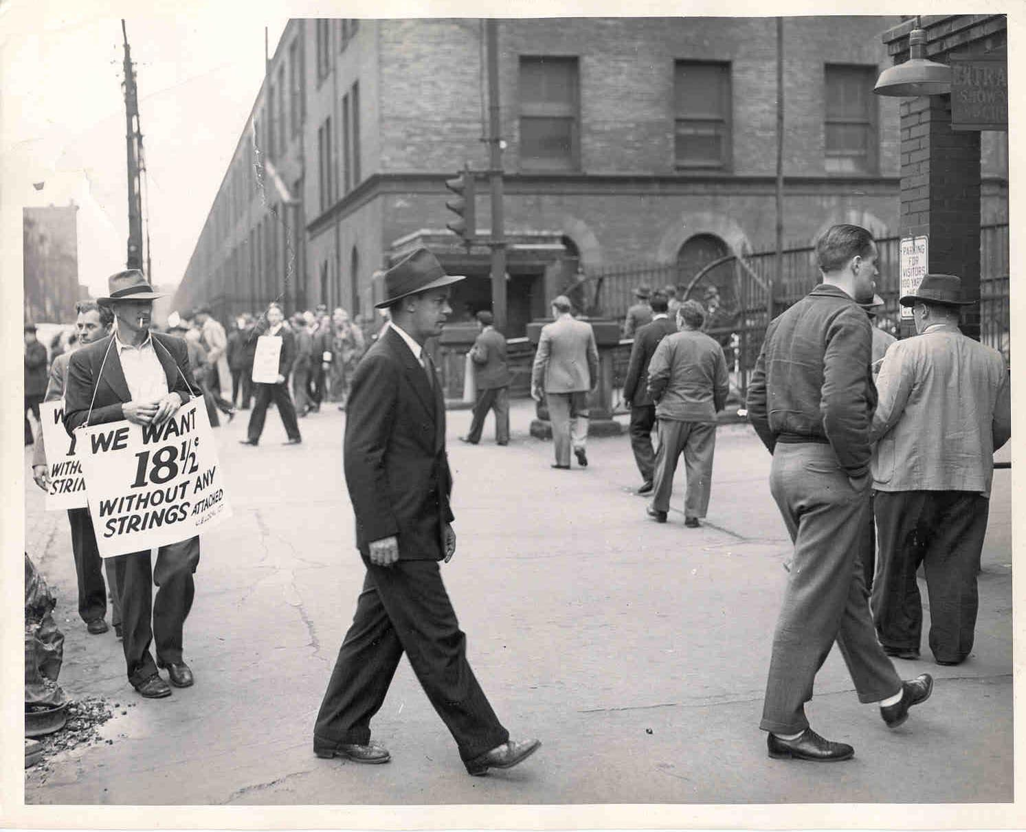 """State police clearing a part of crowd from street and sidewalk in front of  struck Westinghouse plant today."" March 26, 1946"